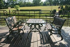 On terrace. Table and benches on terrace Stock Image