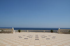 The terrace. Majestic terrace of a five stars hotel in front of the sea Royalty Free Stock Images