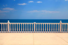 Terrace with balustrade overlooking the sea. Summer view with classic white balustrade and empty terrace overlooking the sea (Italy Royalty Free Stock Photos