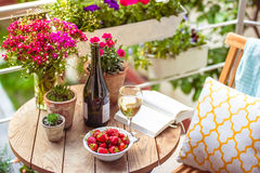 Terrace. Beautiful terrace or balcony with small table, chair and flowers Stock Photos