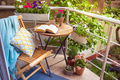 Terrace. Beautiful terrace or balcony with small table, chair and flowers royalty free stock photography