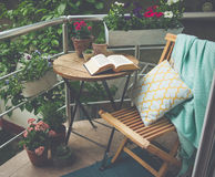 Terrace. Beautiful terrace or balcony with small table, chair and flowers. Toned image Royalty Free Stock Photos