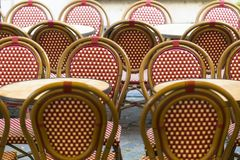 Terrace of a cafeteria in Antwerp Belgium with wicker chairs a. Nd tables retro stock photos