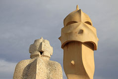 Terrace of the Casa Mila or La Pedrera building with chimneys shaped anthropomorphic soldiers. BARCELONA, CATALONIA, SPAIN Royalty Free Stock Images