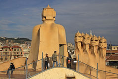 Terrace of the Casa Mila or La Pedrera building with chimneys shaped anthropomorphic soldiers. BARCELONA, CATALONIA, SPAIN Royalty Free Stock Photo