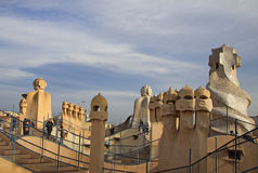 Terrace of the Casa Mila or La Pedrera building with chimneys shaped anthropomorphic soldiers. BARCELONA, CATALONIA, SPAIN Royalty Free Stock Photography