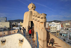 Terrace of the Casa Mila or La Pedrera building with chimneys shaped anthropomorphic soldiers. BARCELONA, CATALONIA, SPAIN Royalty Free Stock Image