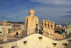 Terrace of the Casa Mila or La Pedrera building with chimneys shaped anthropomorphic soldiers. BARCELONA, CATALONIA, SPAIN Stock Photo