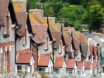 Terrace Cottage Roof tops. A row of english cottages, showing red tiled rooftops. These are in the Dorset village of Beer Stock Image