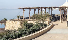 Terrace on Dead sea. Terrace with tables and chairs on the shore of the Dead Sea in Jordan on a cloudy day Royalty Free Stock Photos