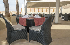 Terrace on Dead sea. Terrace with tables and chairs on the shore of the Dead Sea in Jordan on a cloudy day Stock Image