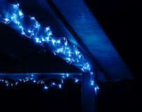 Terrace decorated with blue LED-garland Royalty Free Stock Photos