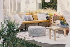 Free Terrace Design Idea With Rattan Garden Furniture Set And Cozy Pillows And Rug, Real Photo Royalty Free Stock Photography - 149750637