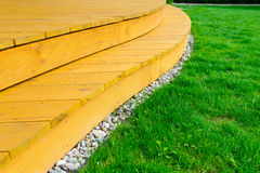 Terrace in formal garden after power washing - bright green lawn Stock Photos