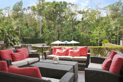 Patio in front of the australian jungle. Patio of 'Byron at Byron Resort and Spa in front of the Australian jungle located near Byron Bay stock photos