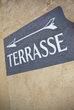 Terrace sign on a wall. Terrace French sign on a plastered wall Royalty Free Stock Images