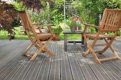 Terrace in garden. Relaxing wooden terrace in a garden royalty free stock photo