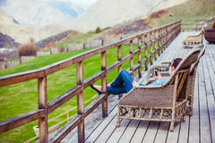 Terrace. Girl sitting on terrace with beautiful mountain view Royalty Free Stock Photos
