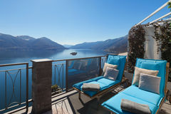 Terrace of house. With comfortable sun beds, lake view Royalty Free Stock Photo