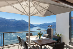 Terrace of house. With dining table and lake view Stock Images