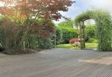 Terrace In A Garden With Japanese Maple Foliage Stock Photography