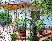 Terrace through iron work. Sunny terrace through art iron work Royalty Free Stock Photo