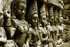 Terrace of the Leper King. Ornate bas-reliefs at the Terrace of the Leper King, in the premises of Angkor Thom, Cambodia Royalty Free Stock Images