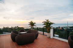 Terrace lounge with rattan armchairs and seaview. In a luxury resort Royalty Free Stock Photo