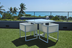 Terrace lounge with white rattan armchairs Stock Photo