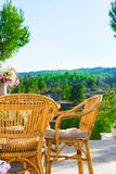 Terrace of luxurious white villa with wicker chairs table flowers bouquet on table fascinating view of valley mountains royalty free stock images