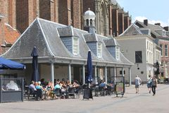 People enjoy at a cosy terrace in medieval ambiance, Amersfoort, Netherlands Royalty Free Stock Photo