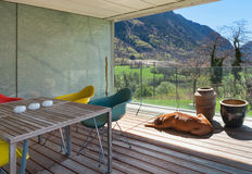 Terrace of a modern mountain house. Panoramic view Royalty Free Stock Image