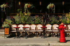 Terrace in Montreal. Open terrace with round tables and wicker chairs in Montreal, Quebec in Canada stock images