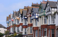 Terrace of older homes with blue sky. A row of terraced houses with colored beams and bay fronted windows Royalty Free Stock Images