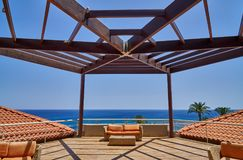 Hotel terrace at the seaside. Terrace with orange sofas with sea views stock photo