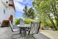 Terrace with outdoor furniture in back yard. Stock Photography
