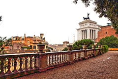 Terrace overlooking historic Rome city Italy. Modern terrace in front of Piazzale Caffarelli at Capitolini hill offering beautiful views and Altar of the Royalty Free Stock Images