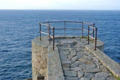 Terrace overlooking the sea. Stone terrace with iron railings on the Atlantic Ocean Stock Photo