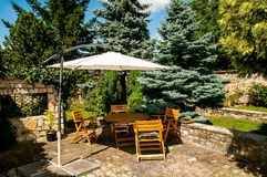 Terrace with parasol. And garden furniture Stock Photo