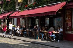 Terrace with parisians sunny lunch