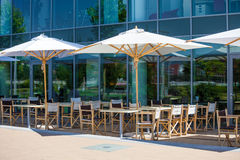 Terrace restaurant area with white umbrellas Stock Images