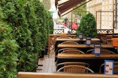 Terrace restaurant. Next to the green trees stock photos