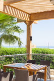Terrace of restaurant overlooking the sea and palm trees Stock Photography