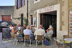 Terrace of restaurant in a small street of the fortified city of Royalty Free Stock Images