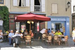 Terrace of restaurant in a small street of the fortified city of Stock Photography