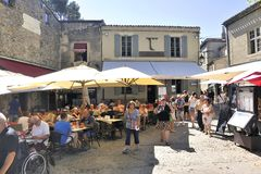 Terrace of restaurant in a small street of the fortified city of Stock Photo