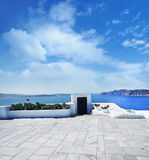 Terrace on Santorin island with a view on azure Mediterranean se Royalty Free Stock Photos