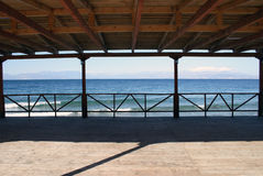 Terrace by the sea. Sea panorama from wooden terrace Royalty Free Stock Photo