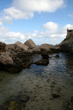 Terrace on the sea and concrete blocks. Protection dam with blocks breakwater Stock Images