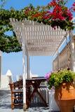 Terrace setting in Thira, Santorini Stock Images